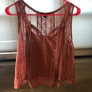 cute orange top with designs and under shirt
